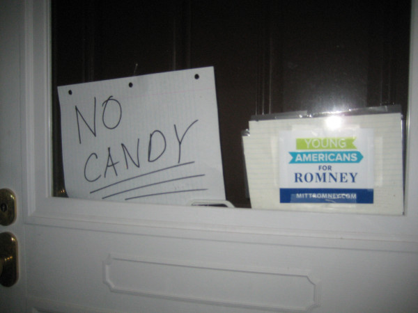 Romney supporters refuse to provide free handouts on Halloween.