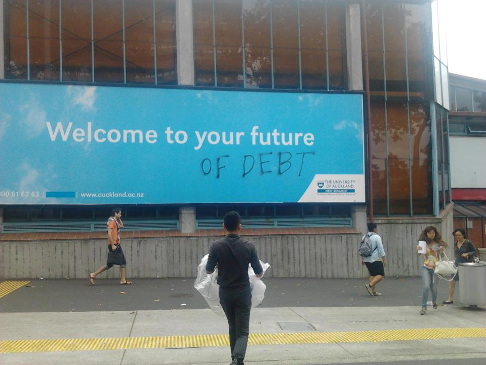Graffiti makes university's welcome sign way more honest.