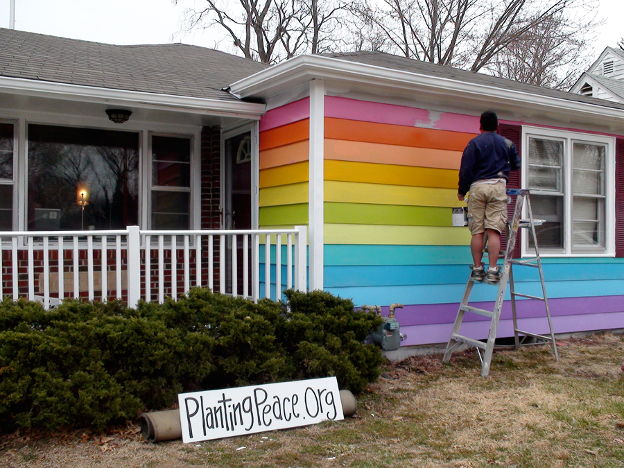 House across the street from Westboro Baptist Church headquarters being painted to look like a giant gay pride flag.