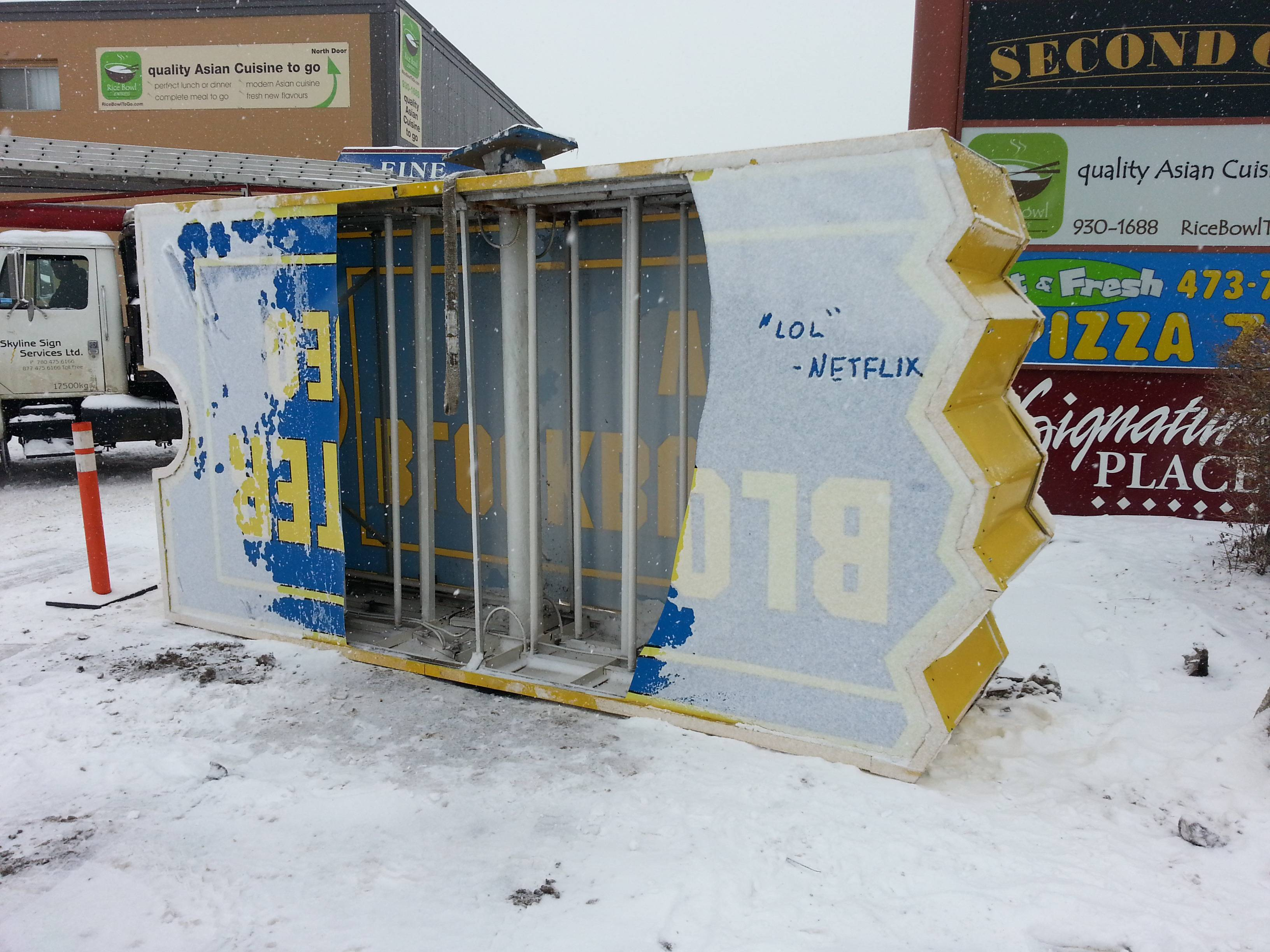 Message on fallen Blockbuster sign adds insult to injury.