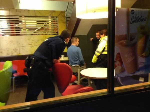 Police called to free a drunk man stuck in a high chair at McDonald's. Photo went viral real fast.