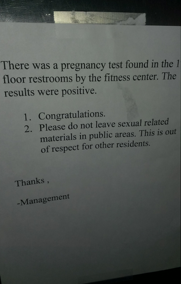 Elevator sign has special message for whoever took pregnancy test in fitness center bathroom.