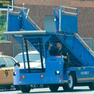 Airport worker takes stair car to lunch, sets new bar for borrowing office supplies.