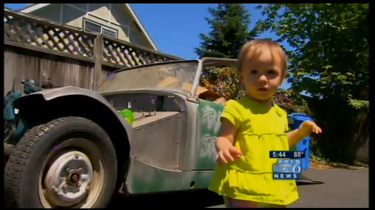 Toddler buys car on eBay by slapping her fat baby hands on dad's iPhone.