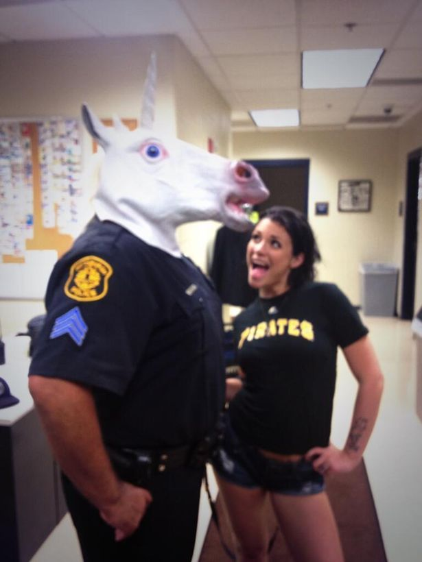 A police officer is in trouble for taking a picture with a porn star while wearing a unicorn mask. You read that right.