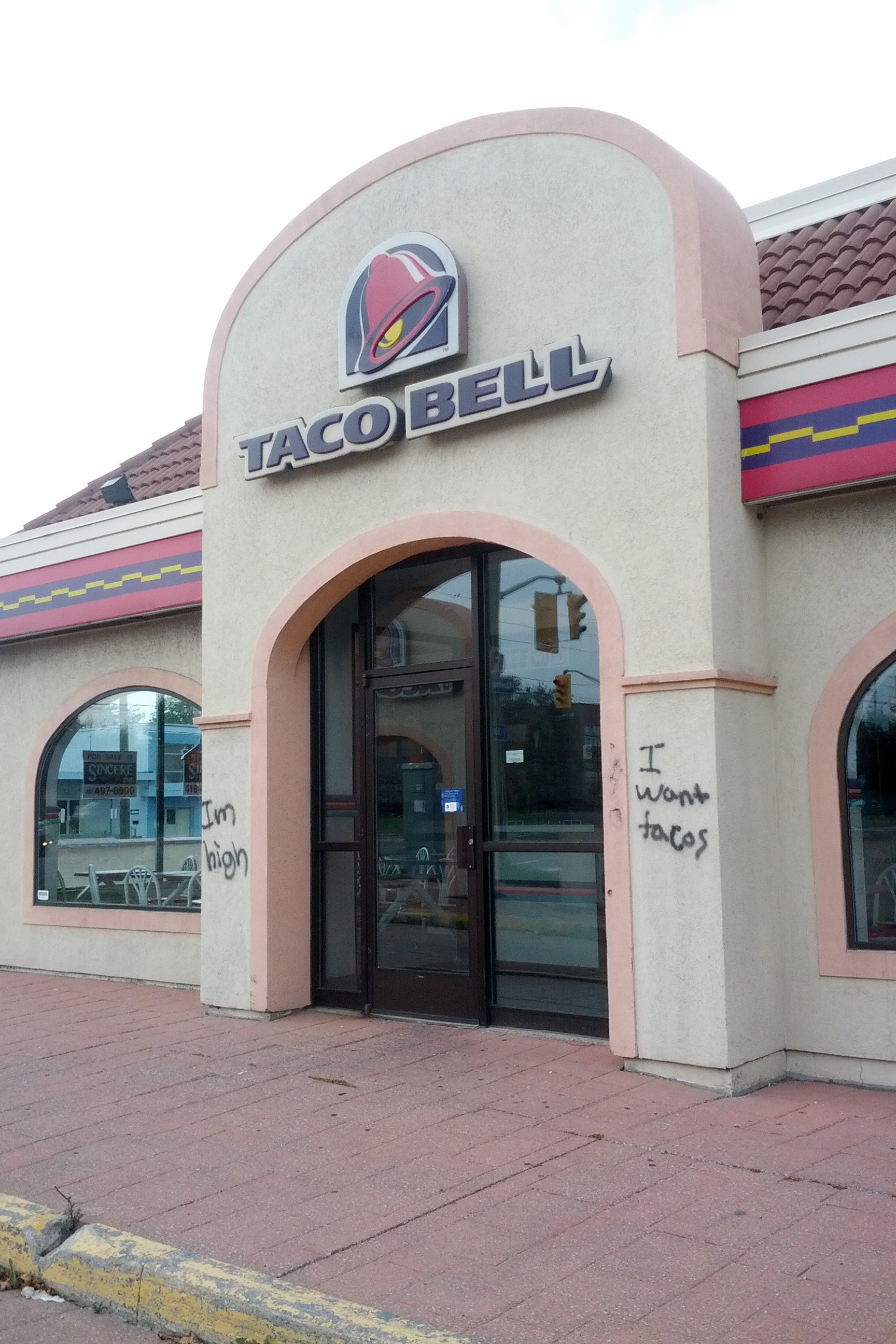 Someone was bummed that their Taco Bell closed down. So they spray-painted a little message.