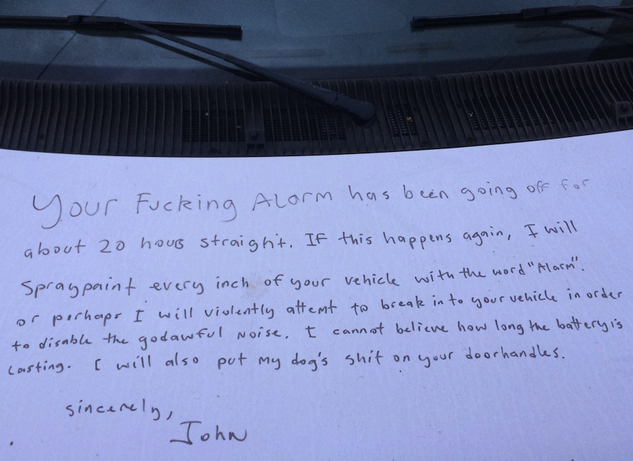 A car alarm was going off for hours. So a neighbor used a marker to write this angry note directly on the car.