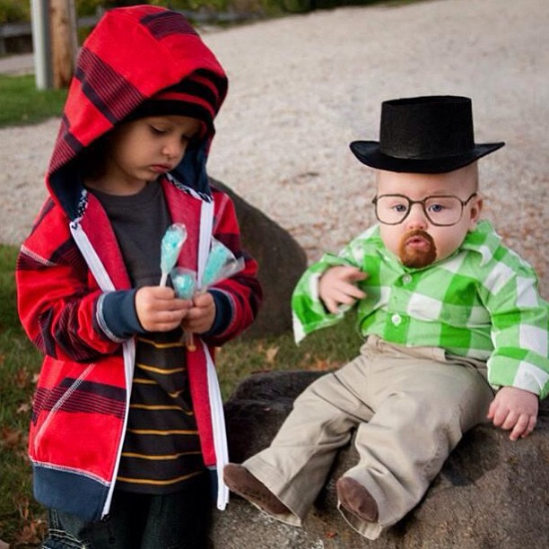12 babies dressed in Halloween costumes they can't possibly understand.