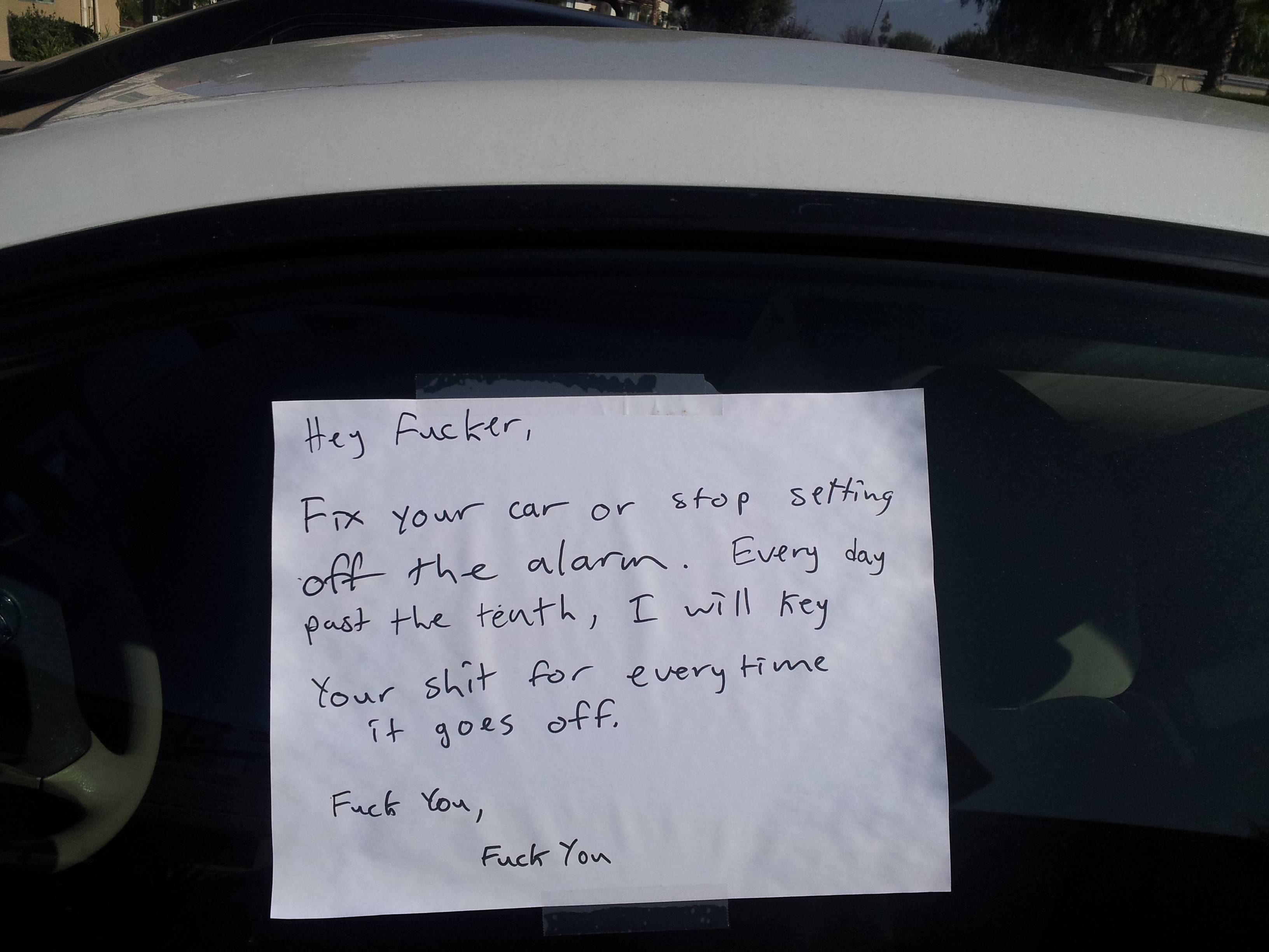 Someone got super pissed about a car alarm. They left a note.