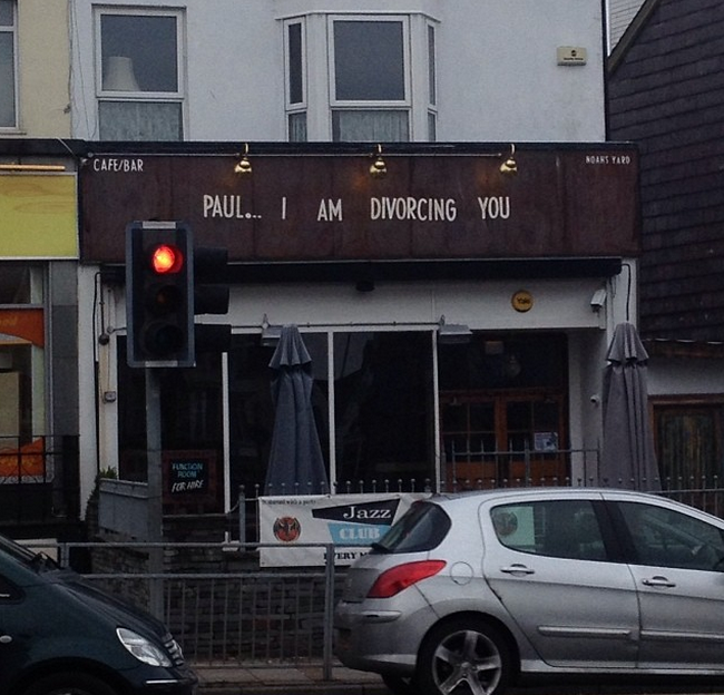 A woman told her husband about divorce with a bar sign. Pour, guy.