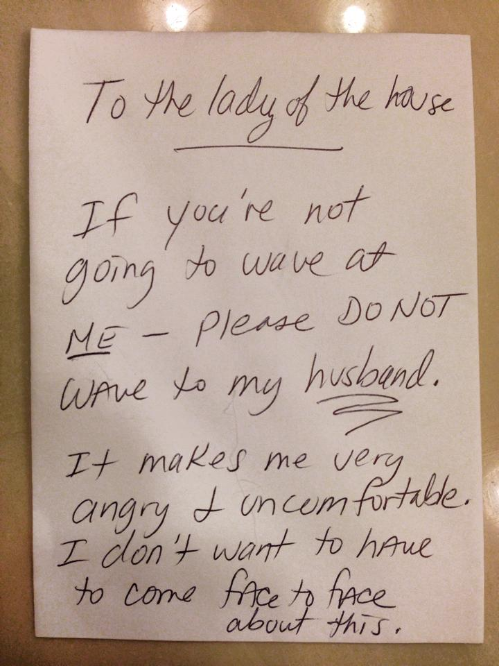 If this angry note is to be believed, waving at your neighbors can be considered a hostile act.