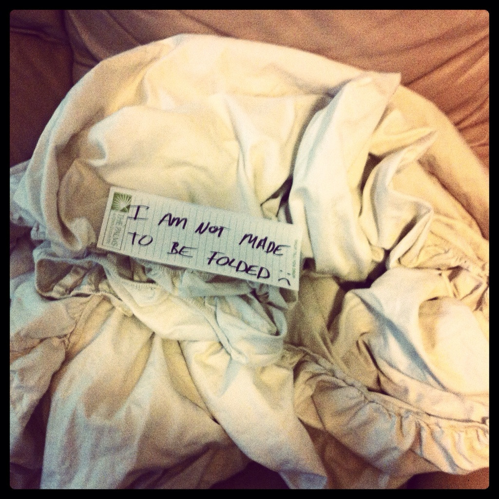 A woman asked her husband to fold a fitted sheet. Here's what she found.