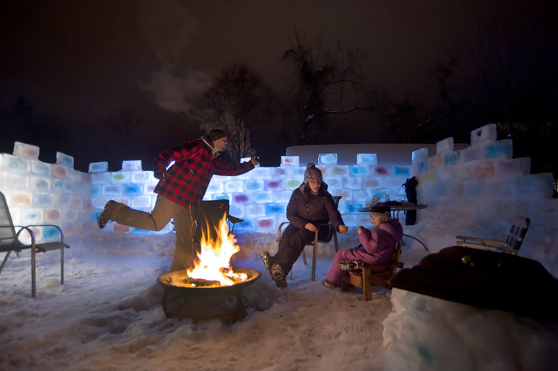 Some dude has taken advantage of this winter's cold weather to build himself a giant, multi-colored ice fort.