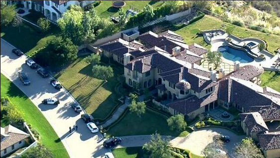 Police raid Justin Bieber's house and arrest his pal on drug charges. Neighborhood is left walking on egg shells.