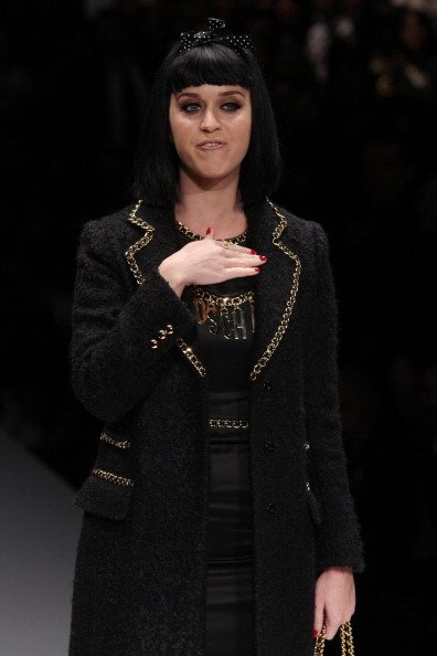 Katy Perry was booed at a fashion show for being late. She didn't roar, but did tell them to zip it.