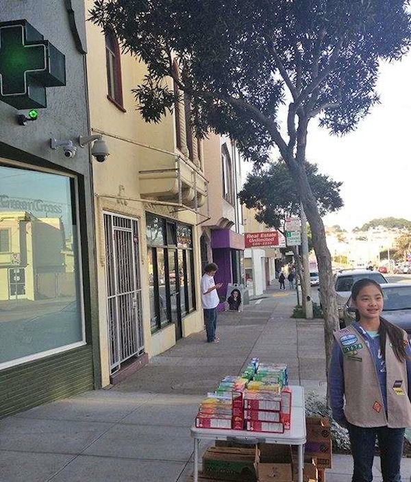 Girl Scout sets up shop in front of a marijuana dispensary.