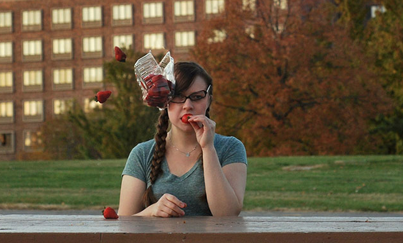 A Photographer has gone viral with photos of random objects being thrown at her head.