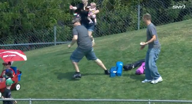 This Mets fan almost lost his kid while going after a foul ball at Spring Training.