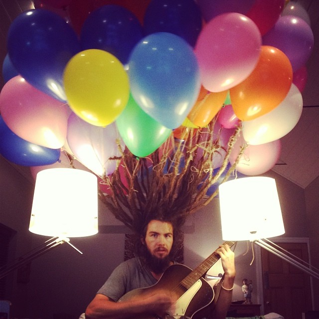 Here's what it looks like when someone ties a bunch of balloons to his dreadlocks.