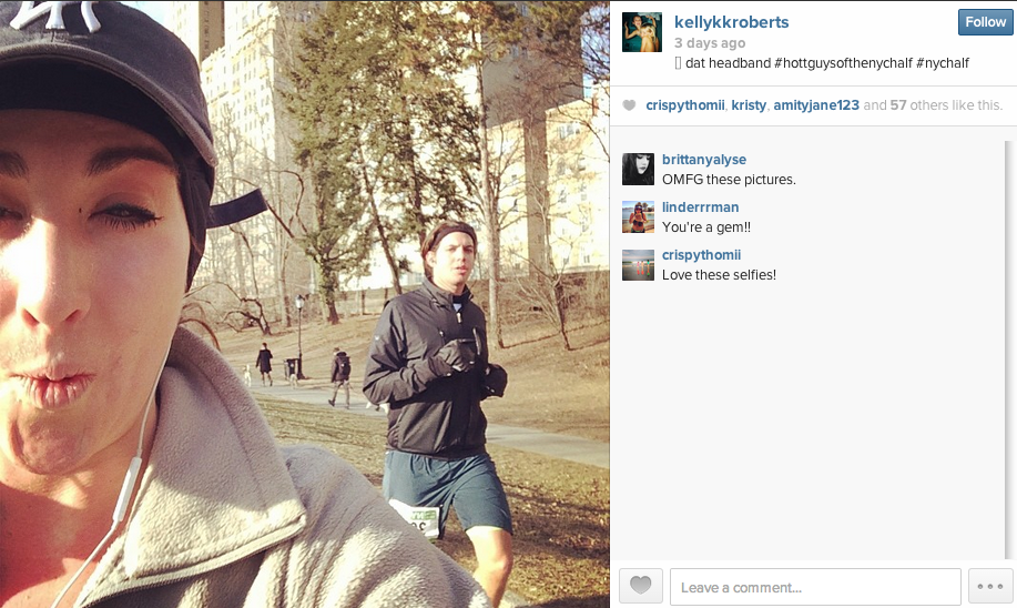 Half-marathon runner passes time on her run by taking selfies with hot guys.