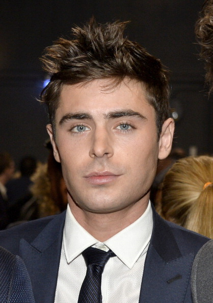 Zac Efron was punched in the face while hanging around a shady neighborhood.