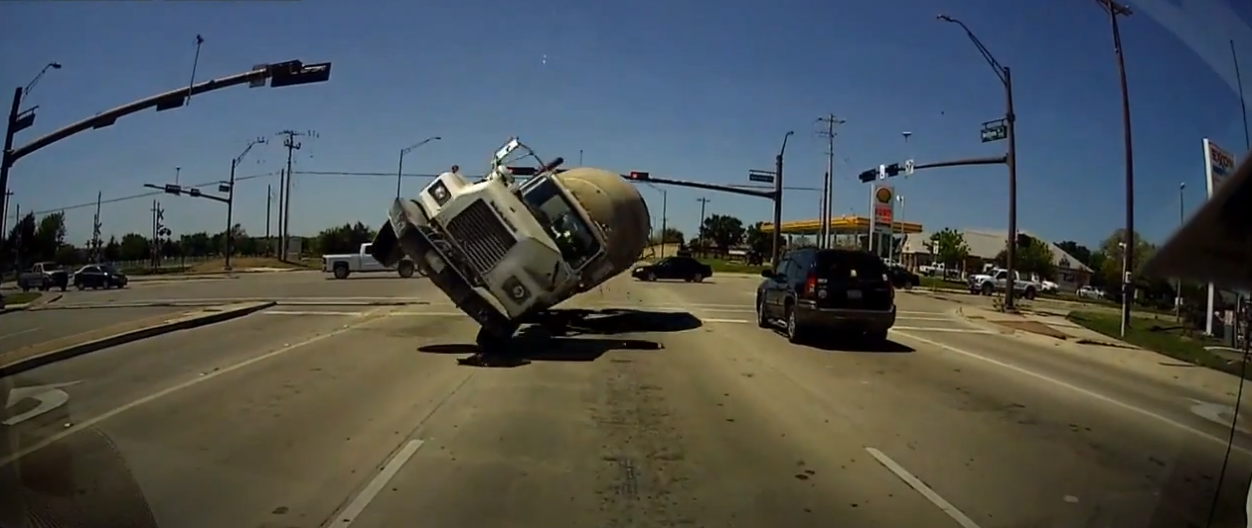 A dash cam captured a head-on collision with a cement truck that everyone somehow walked away from.