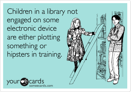 Children in a library not engaged on some electronic device are either plotting something or hipsters in training.
