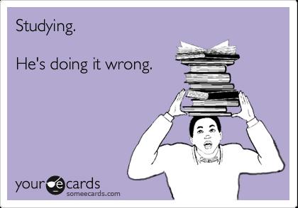 Studying.  He's doing it wrong.