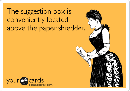 The suggestion box is conveniently located above the paper shredder.