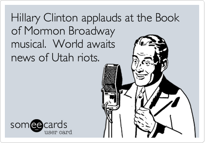 Hillary Clinton applauds at the Book of Mormon Broadway